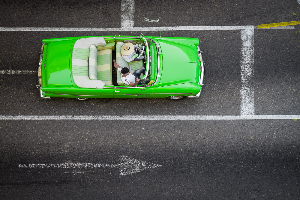 aerial view of a classic car driving the city roads, Havanna, Cuba